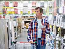 Man in store building materials Royalty Free Stock Photography