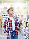 Man in store building materials stock photo