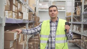 Man store worker using bar code scanner scanning labels on boxes stock video