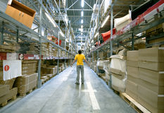 Man in storehouse Stock Photo