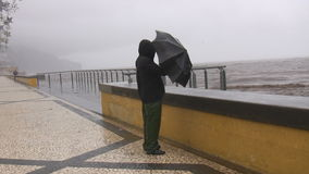 Man in the storm by the sea Royalty Free Stock Photography