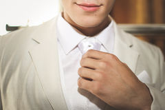 Man straightens his tie Royalty Free Stock Photography