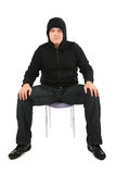 Man is strained, sits on a chair Royalty Free Stock Photo