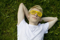 Man  strange sunglasses lying  on grass Royalty Free Stock Image