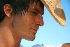 Man with straw hat on the beach Royalty Free Stock Images