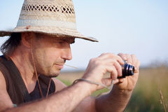 The man in a straw hat with the camera Royalty Free Stock Images