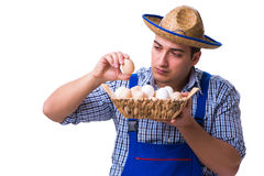 The man with a straw hat and eggs Royalty Free Stock Photography