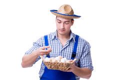 The man with a straw hat and eggs Stock Photography