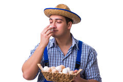 The man with a straw hat and eggs Stock Photo