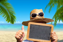 Man with straw hat and sunglasses holds blank slate blackboard Stock Images