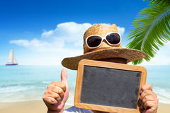 Man with straw hat and sunglasses holds blank slate blackboard Royalty Free Stock Image