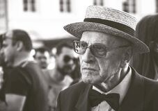Man in Straw Hat Wearing Bow Tie With People Stock Photos