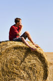 Man on straw rol Stock Photo