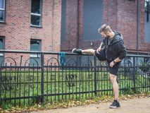 Outdoor streching. Healthy exercising habits. Man is streching outdoors in a city scenery, representing healthy active lifestyle model Stock Photography
