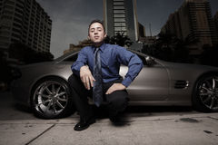 Man on the street with his luxury sports car Stock Photo