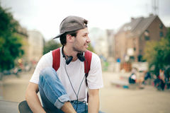 Man on the street. With his skateboard Stock Photography