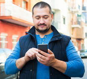 Man on street with phone Royalty Free Stock Photography