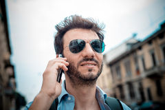 Man in the street on the phone Royalty Free Stock Image
