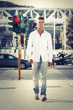 Man in street photography. Walking on sidewalks. Red light Royalty Free Stock Image