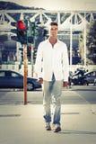 Man in street photography. Walking on sidewalks. Red light Royalty Free Stock Image