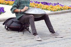 Man on the street plays a percussion instrument hang Royalty Free Stock Images