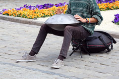 Man on the street plays a percussion instrument hang Stock Photos