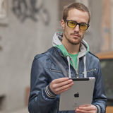 Man On Street Use Ipad Tablet Computer Stock Photo