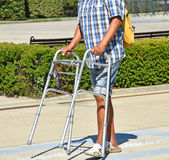 Man on the street with a walker Royalty Free Stock Photography
