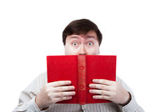 Man in stress holding an open red book Royalty Free Stock Photos