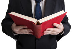 Man in stress holding an open red book Royalty Free Stock Photo