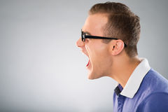 Man in stress. Profile of a furious man Stock Photography