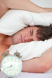 Man stressed by his alarm clock Royalty Free Stock Photo
