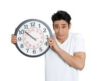 Man stressed holding clock Stock Image