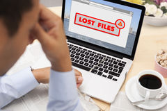 Man stressed because he lost his files Royalty Free Stock Images