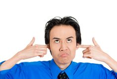 Man stressed by loud noise Stock Images