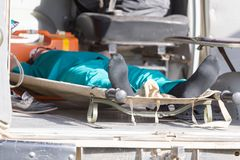 Man on a stretcher in the ambulance Stock Image