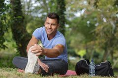 Man stretches body before running Stock Photography