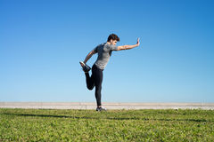 Man stretches the body before running Royalty Free Stock Image