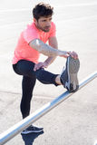 Man stretches the leg Royalty Free Stock Images