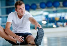 Man stretching Stock Photography