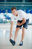 Man stretching Stock Images