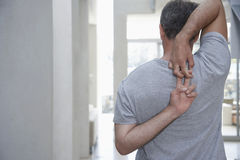 Man Stretching Arms Behind Back royalty free stock photos