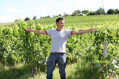 Man stretching arms in vineyard Royalty Free Stock Photo