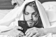 Man stretching in bed. Lazy man happy waking up in the bed rising hands in the morning with fresh feeling relaxed. Man. Morning royalty free stock photo