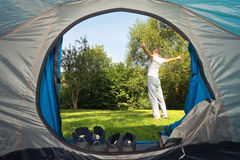 Man stretching on camping Stock Image