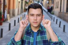 Man stretching ears to hear royalty free stock photo