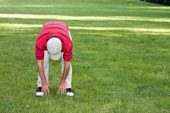 Man Stretching Golf Stock Photo