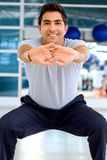 Man stretching at the gym Stock Photography