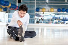 Man stretching at the gym Royalty Free Stock Images
