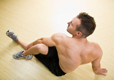 Man stretching in health club Stock Images